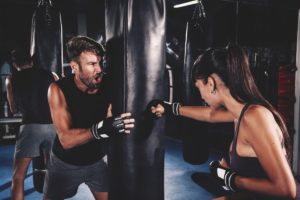 a couple that practicing kickboxing together in a sports hall